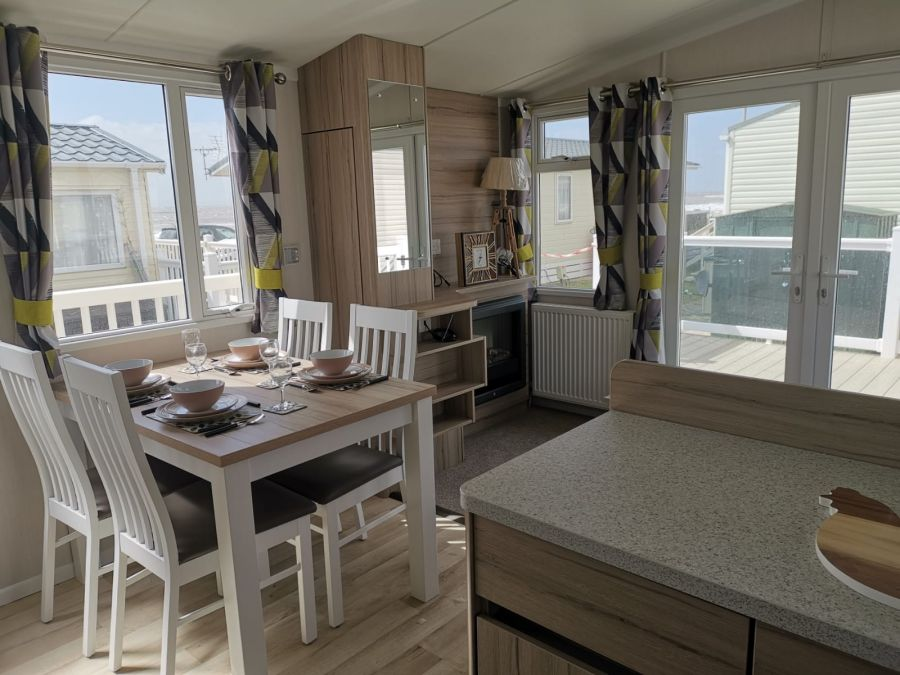 Image of brand new caravan with decking and sea view at trecco bay/porthcawl/south wales
