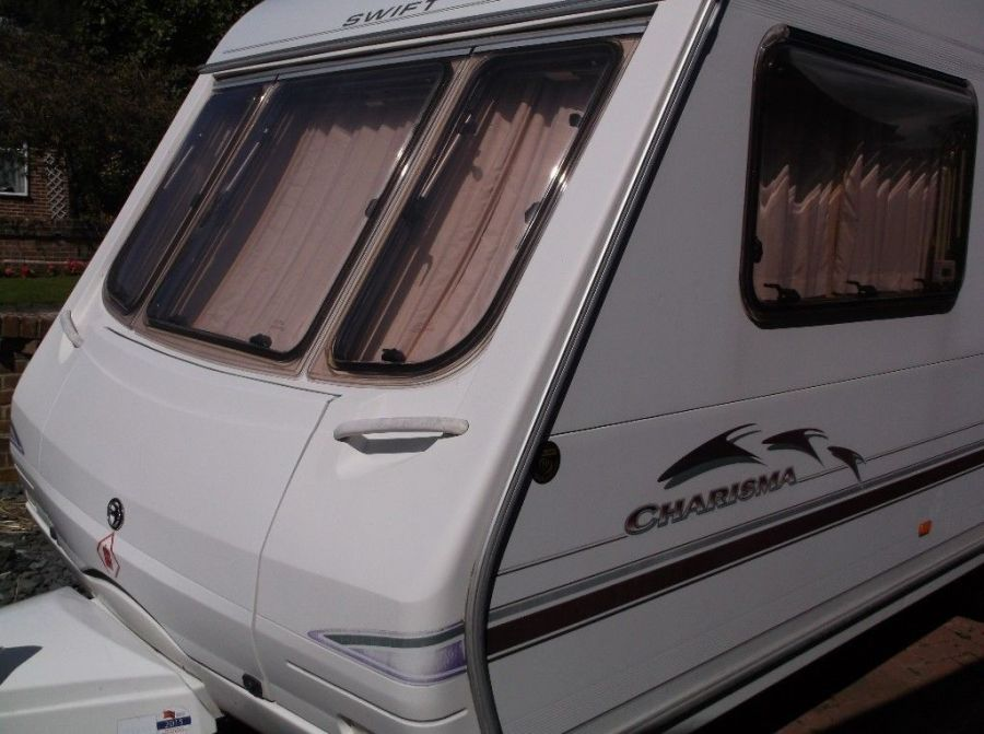 Image of 2003 Swift Charisma 560 3/4berth touring caravan plus many accessories