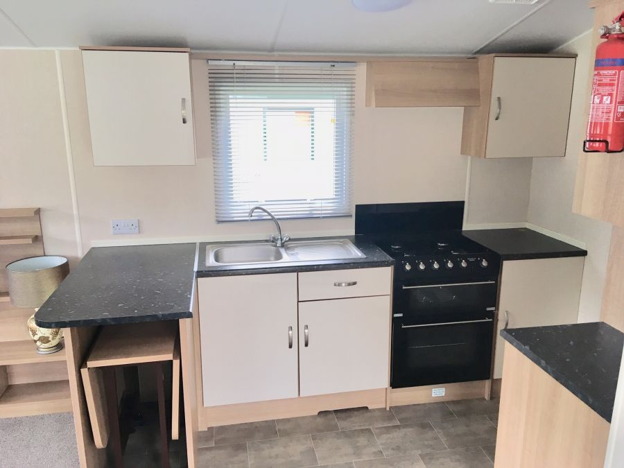 Photo of 6 berth family static caravan for sale. UPVC decking included. No site fees to pay until Jan 2021.