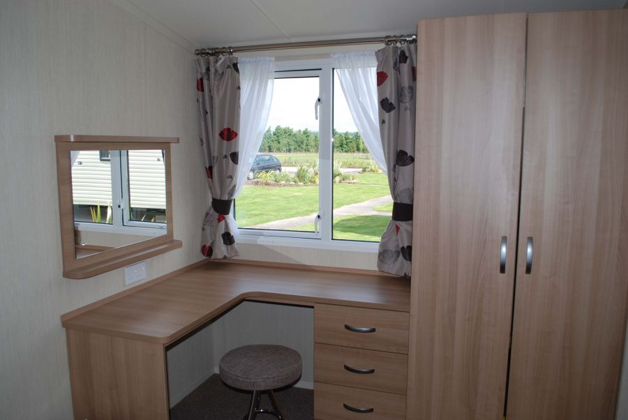 Photo of Beautiful lakes edge family caravan on award winning site.